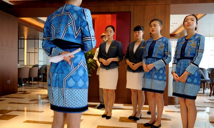 Attendants are trained at the executive lounge of Atlantis Sanya hotel in Sanya, Hainan Province, China on April 28, 2018.    (Bobby Yip/Reuters)