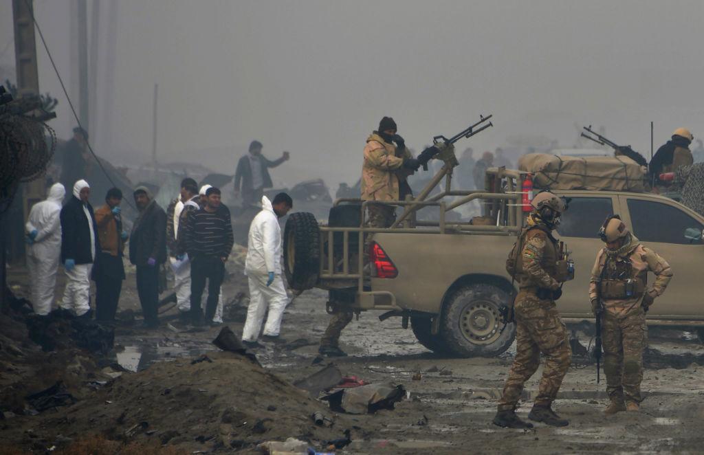 investigators at suicide bomb attack site in Afghanistan