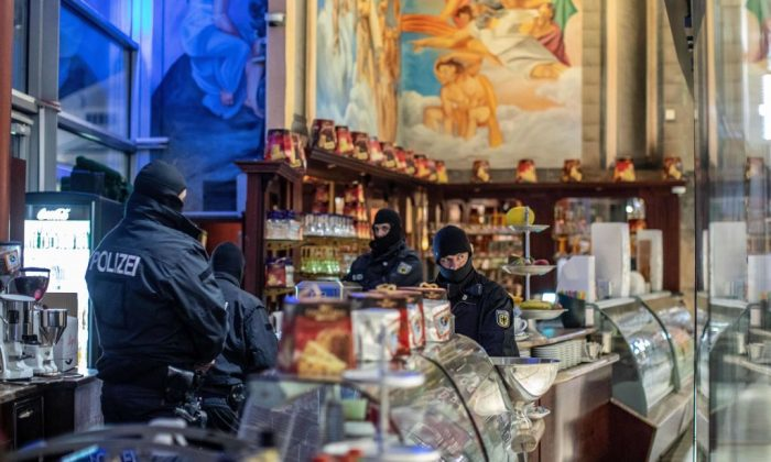 Policemen raid an ice cafe in Duisburg, western Germany, on Dec. 5, 2018. (CHRISTOPH REICHWEIN/AFP/Getty Images)