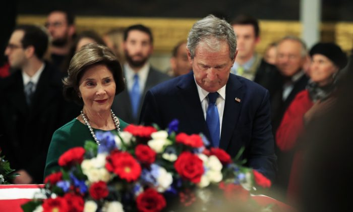 Former President George W. Bush and former First Lady Laura Bush pay their respects to his father former President George H.W. Bush as he lie in state at the U.S. Capitol in Washington, on Dec. 4, 2018. (Manuel Balce Ceneta/AP Photo)