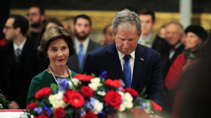 Former President George W. Bush and former First Lady Laura Bush pay their respects to his father former President George H.W. Bush as he lies in state at the U.S. Capitol in Washington, Dec. 4, 2018. (Manuel Balce Ceneta/AP Photo)