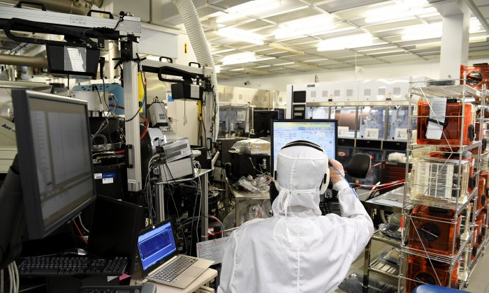 An engineer works in the clean room facilities at the LETI, a French research institute for electronics and information technologies founded by the French Alternative Energies and Atomic Energy Commission (CEA). (JEAN-PIERRE CLATOT/AFP/Getty Images)