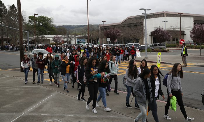 James Logan High School students walk out of class during a walk out demonstration in Union City, Calif. on March 14, 2018. (Justin Sullivan/Getty Images)
