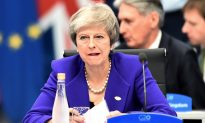 UK PM May's Party Opposes Her Brexit Deal as Economy Slows