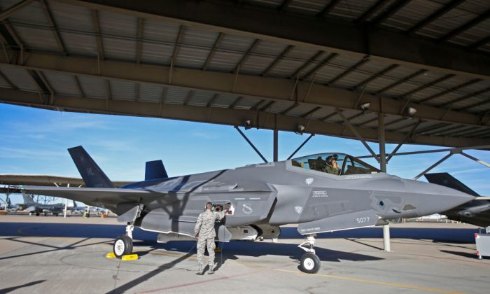 A ground crew member checks out an F-35 plane before a training mission at Hill Air Force Base in Ogden, Utah, on March 15, 2017. (George Frey/Getty Images)
