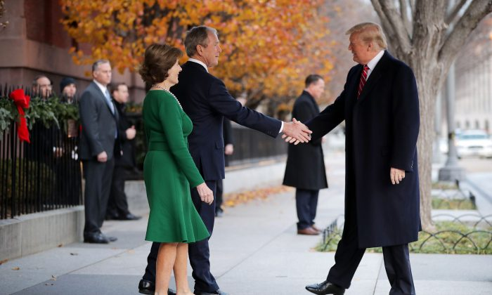 Former First Lady Laura Bush and former President George W. Bush greet President Donald Trump outside of Blair House in Washington on Dec. 4, 2018. (Chip Somodevilla/Getty Images)