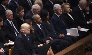 President Trump Shakes Former President Obama's and First Lady's Hand During Funeral
