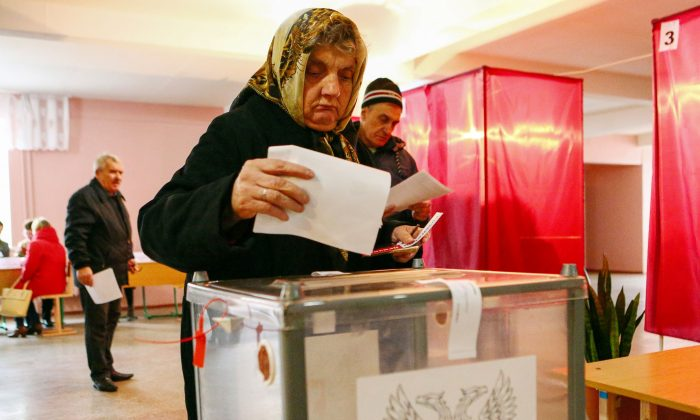 People cast their ballots at a polling station in Donetsk, in the rebel-held area of eastern Ukraine on Nov. 11, 2018. (Aleksey Filippov/AFP/Getty Images)