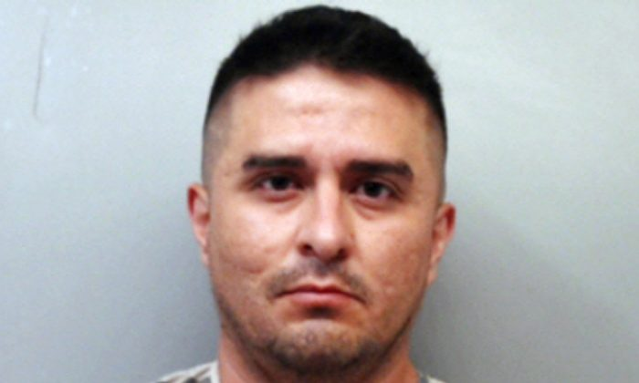 U.S. Border Patrol agent Juan David Ortiz. Ortiz, who confessed to shooting four women in the head and leaving their bodies on rural Texas roadsides, was indicted Dec. 5, 2018, on a capital murder charge.  (Webb County Sheriff's Office via AP)