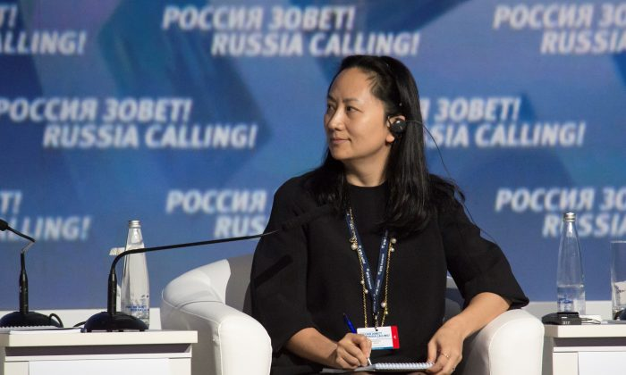 "Meng Wanzhou, Executive Board Director of the Chinese technology giant Huawei, attends a session of the VTB Capital Investment Forum ""Russia Calling!"" in Moscow on Oct. 2, 2014. (Alexander Bibik/Reuters)"