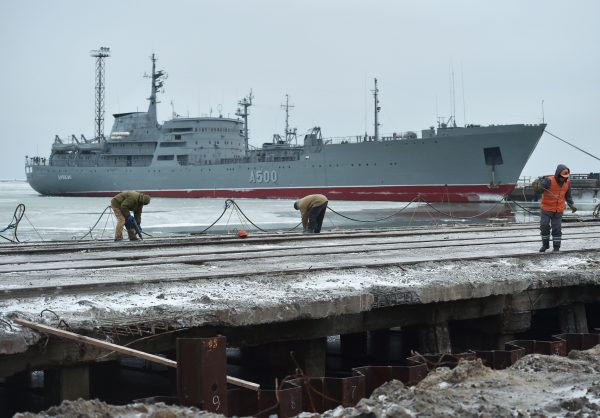 The Ukrainian command ship Donbass is seen moored as workers build new terminal at the Port of Mariupol on the Azov Sea, eastern Ukraine, on Dec. 2, 2018.