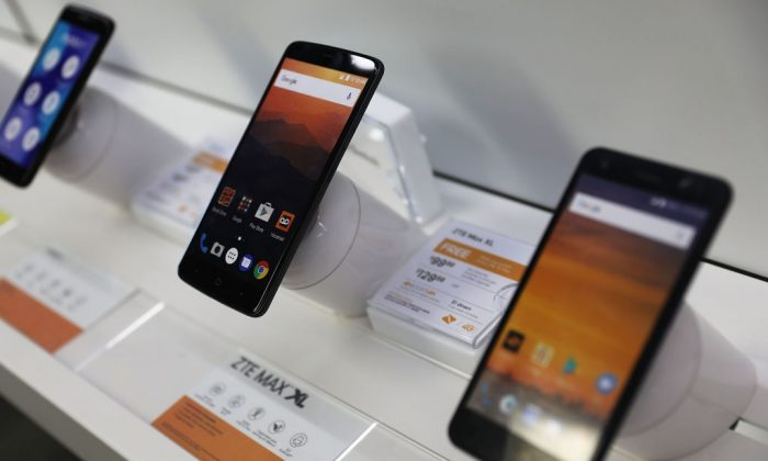 Two cell phones manufactured by ZTE, China's No. 2 smartphone maker, are seen on a store shelf in Miami, Florida, on May 14, 2018. (Joe Raedle/Getty Images)
