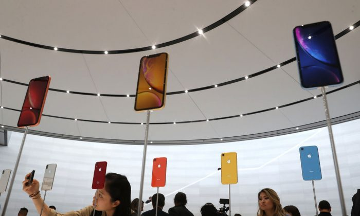 The new Apple iPhone XR is displayed during an Apple special event at the Steve Jobs Theatre  in Cupertino, California, on Sept. 12, 2018. (Justin Sullivan/Getty Images)