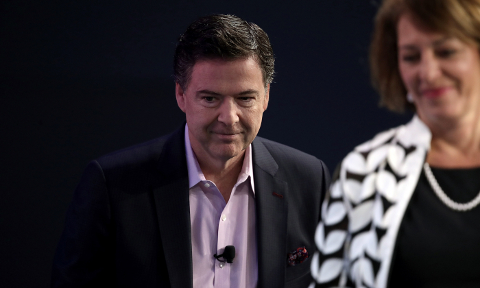 Former FBI director James Comey (L) arrives for an interview forum with investigative reporter Carol Leonnig at The Washington Post, on May 8, 2018 in Washington. Comey discussed his stormy tenure as head of the FBI during the forum. (Win McNamee/Getty Images)