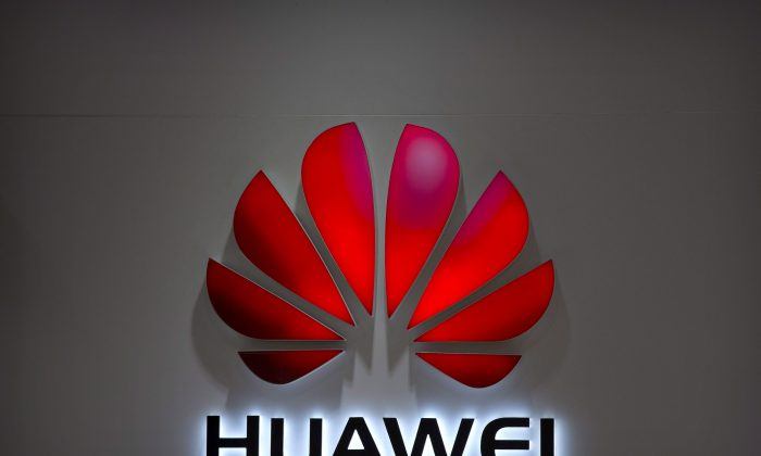 The Huawei logo is seen at a Huawei store at a shopping mall in Beijing on July 4, 2018. (AP Photo/Mark Schiefelbein, File)