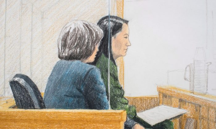 In this courtroom sketch, Meng Wanzhou (L), the chief financial officer of Huawei, sits with a translator during a bail hearing at B.C. Supreme Court in Vancouver, on Dec. 10, 2018. (The Canadian Press/Jane Wolsak)