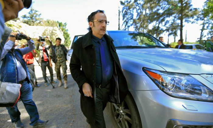 A member of a Yemeni rebel delegation prepares to fly accompanied by a UN peace envoy, heading for high-stakes talks in Sweden with the government aimed at ending the country's devastating war, on Dec. 4, 2018 in Sanaa. (Mohammed Huwais/AFP/Getty Images)