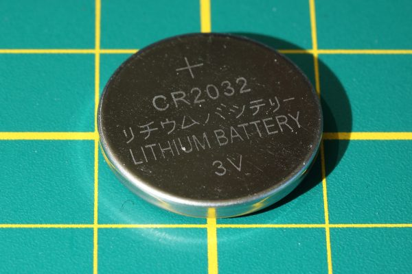 closeup photo of a button battery