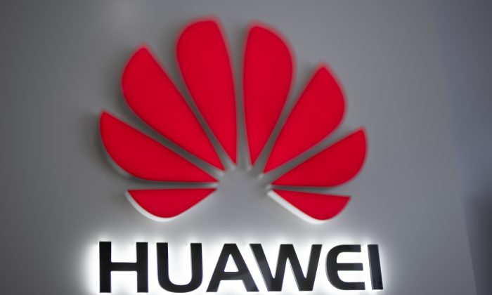 The Huawei logo is displayed at a store in Beijing, China, on Dec. 6, 2018. (Fred Dufour/AFP/Getty Images)