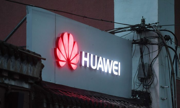 A Huawei sign outside a store selling mobile phones in Beijing on Aug. 6, 2018. (Greg Baker/AFP/ Getty Images)