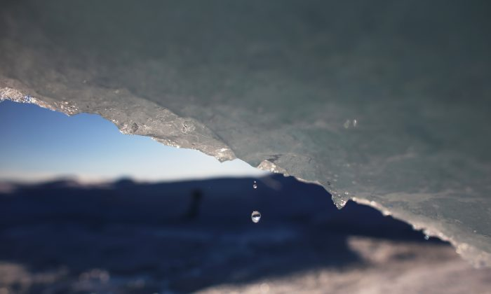 In this file photo, part of the glacial ice sheet that covers about 80 percent of the country is seen on July 17, 2013, on the Glacial Ice Sheet, Greenland. Are the polar ice caps growing or shrinking, and is it the result of human activity? Do we even need to ask this question anymore? (Joe Raedle/Getty Images)