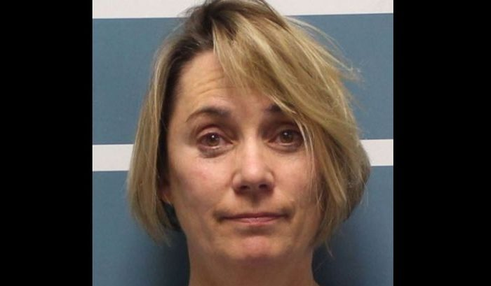 Margaret Gieszinger, 52, was arrested after police got word of a teacher endangering students with scissors at University Preparatory High School in Visalia, Calif., according to the Visalia Times-Dispatch in a Dec. 5 report. (Tulare County Sheriff's Office)
