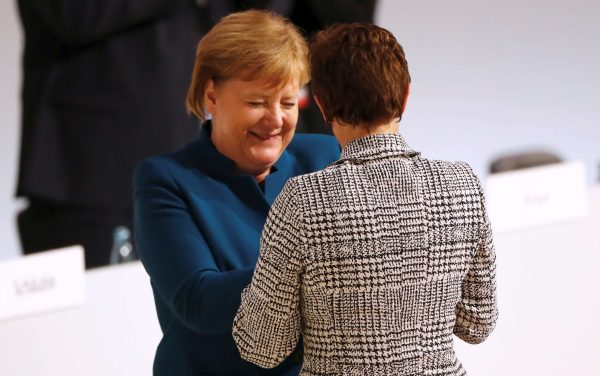 Annegret Kramp-Karrenbauer is congratulated by German Chancellor Angela Merkel