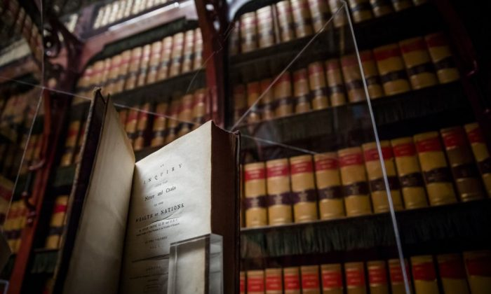 "A first-edition of ""The Wealth of Nations"" by Scottish economist and philosopher Adam Smith at the library of the Dutch House of Representatives in The Hague on May 31, 2018. Smith was a classical liberal, the forebearer of today's libertarians. (BART MAAT/AFP/Getty Images)"
