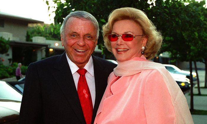 Frank Sinatra, left, and his wife Barbara arrive at Our Lady of Malibu church to renew their wedding vows on their 20th wedding anniversary in Malibu, Calif on July 11, 1996.  (AP Photo/Mark J. Terrill, File)