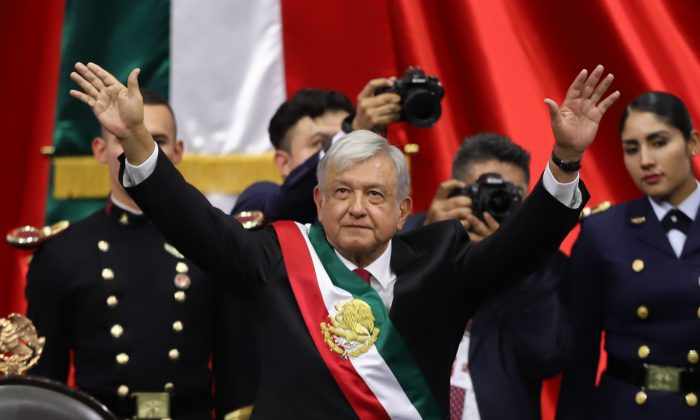 Newly appointed Mexican President Andrés Manuel López Obrador waves after his swearing-in ceremony, in Mexico City, on Dec. 1, 2018. (Getty Images)