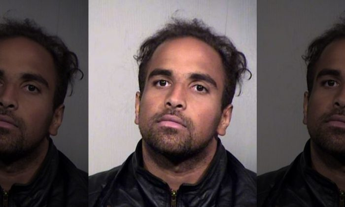 Booking photo of Andre Marc Sutherland, who was arrested after he broke into an apartment in Phoenix, and was punched in the face by a 13-year-old boy. (Maricopa County Sheriff's Office)