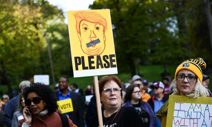 People protest against President Donald Trump near the Tree of Life Congregation in Pittsburgh, Pennsylvania on Oct. 30, 2018. Protesters blamed Trump's allegedly divisive rhetoric for the mass shooting at the synagogue. (BRENDAN SMIALOWSKI/AFP/Getty Images)
