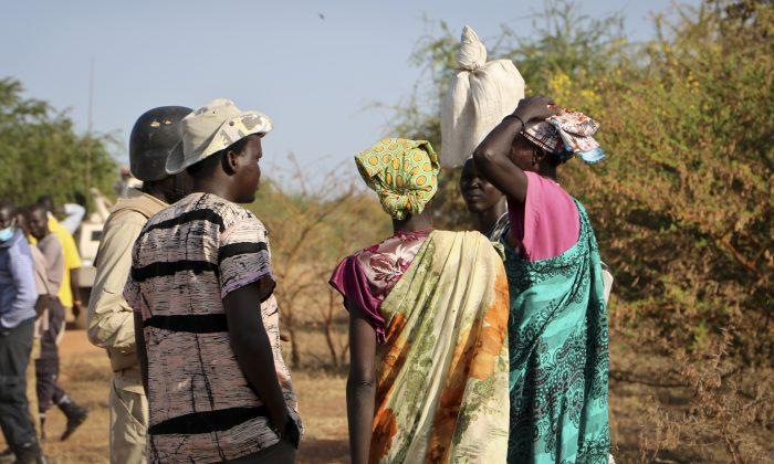Women and girls speak to members of a UN peacekeeping patrol as they walk to get food in South Sudan, Dec. 7, 2018. (Sam Mednick/AP)
