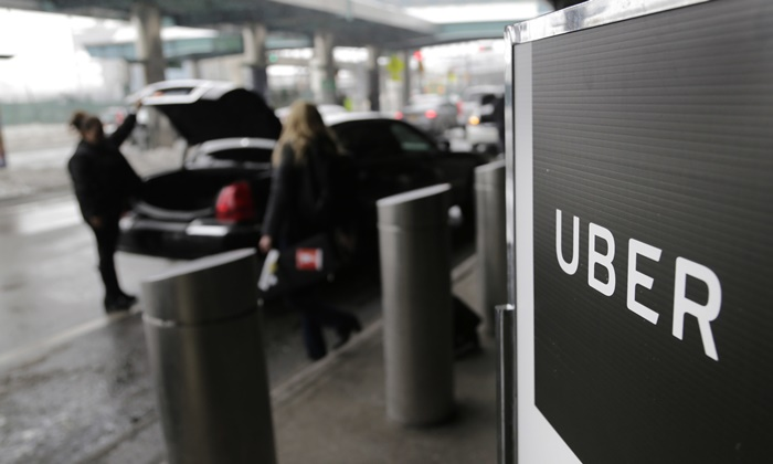Uber offers drivers a way to make extra money, but that can come with a high price in terms of mental well-being. (AP/Seth Wenig)