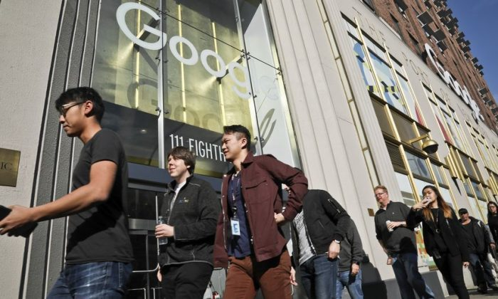 Google employees walk off the job on Nov. 1, 2018, protesting against what they said is the tech company's mishandling of sexual misconduct allegations against executives in New York. (Bebeto Matthews/AP Photo)