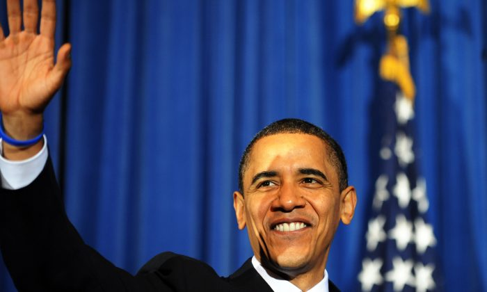 Former U.S. President Barack Obama waves at the audience members during a rally celebrating the passage and signing into law of the Patient Protection and Affordable Care Act health insurance reform bill at the Interior Department in Washington on March 23, 2010.(JEWEL SAMAD/AFP/Getty Images)