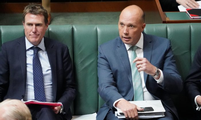 Australia's Attorney-General, Christian Porter (L), and Minister for Home Affairs Peter Dutton are seen during Question Time in the House of Representatives at Parliament House in Canberra, Australia, on Sept. 13, 2018. (Stefan Postles/Getty Images)