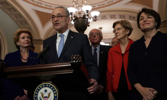 U.S. Senate Minority Leader Sen. Chuck Schumer (D-NY) speaks to members of the media as (L-R) Sen. Debbie Stabenow (D-MI), Sen. Bernie Sanders (I-VT), Senate Minority Whip Sen. Richard Durbin (D-IL), Sen. Elizabeth Warren (D-MA), and Sen. Amy Klobuchar (D-MN) look on after a leadership election at the U.S. Capitol in Washington, on Nov. 18, 2018. (Alex Wong/Getty Images)