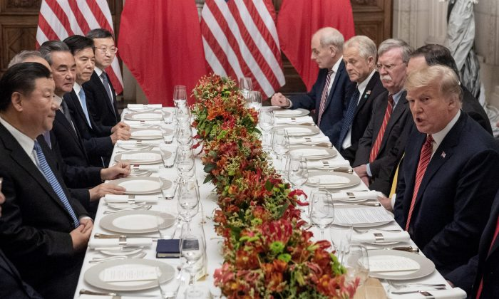 President Donald Trump and members of his delegation hold a dinner meeting with Chinese leader Xi Jinping and Chinese government representatives, at the end of the G-20 Leaders' Summit in Buenos Aires, Argentina, on Dec. 1, 2018.  (SAUL LOEB/AFP/Getty Images)