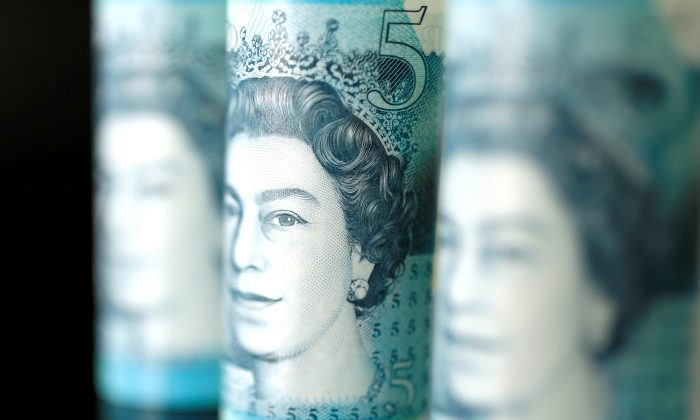 British five pound banknotes are seen in this picture illustration taken November 14, 2017. (Benoit Tessier/Illustration/File Photo/Reuters)