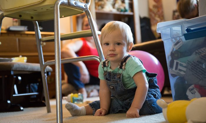 """Adrian Veum plays at home. Nicole Veum says she's loving being his mom, and feels """"reborn."""" (Adam Grossberg/KQED)"""