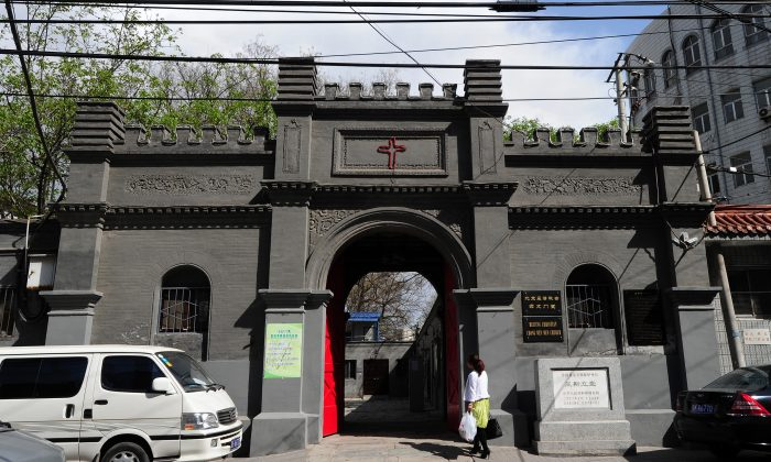 A woman walks to a Christian church in Beijing on April 17, 2011. All religious groups are required to register with the ruling Communist government and worship in officially sanctioned churches. The Beijing Christian Chongwenmen Church, first established in the 1870's by American Methodists and known as Asbury Church, is one of the largest Protestant churches in Beijing. (Frederic J. Brown/AFP/Getty Images)