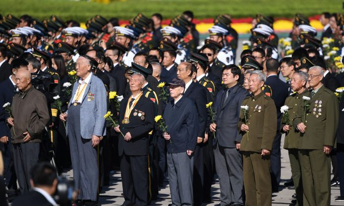 Veterans stand during a ceremony in Beijing's Tiananmen Square, on the eve of National Day on September 30, 2018. (Greg Baker/AFP/Getty Images)