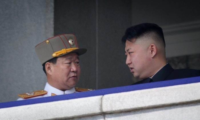 Choe Ryong Hae (L) talks with North Korean leader Kim Jong Un during a military parade in Pyongyang on April 15, 2012. (AFP/AFP/Getty Images)