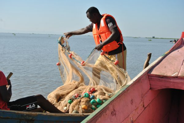 Man is preparing to have his fish net casted on lake victoria