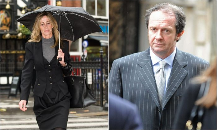 Michelle and Scot Young arrive at the Royal Courts of Justice in London on Nov. 13, 2009. (Leon Neal & Stringer/AFP/Getty Images)