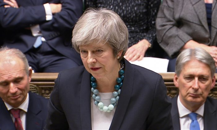 Britain's Prime Minister Theresa May makes a statement in the House of Commons in London on Dec. 10, 2018. (Parliament TV handout via Reuters)