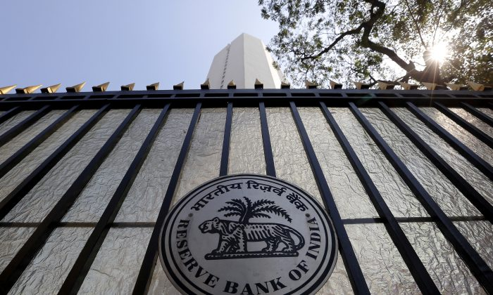 The Reserve Bank of India (RBI) seal is pictured on a gate outside the RBI headquarters in Mumbai, India, on Feb. 2, 2016. (Danish Siddiqui/File Photo/Reuters)