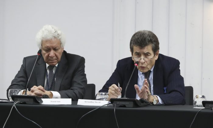 Legal counsel to the tribunal Hamid Sabi and chair to the tribunal Sir Geoffrey Nice QC on the first day of public hearings in London on Dec. 8, 2018. (Justin Palmer)