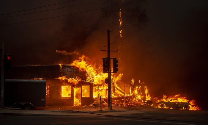 A store burns as the Camp fire tears through Paradise, Calif. on November 8, 2018. (Josh Edelson/AFP/Getty Images)